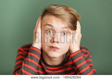 Teenager Covering His Ears