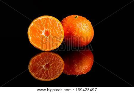 Tangerine with water splash fresh wet clear tropical cut