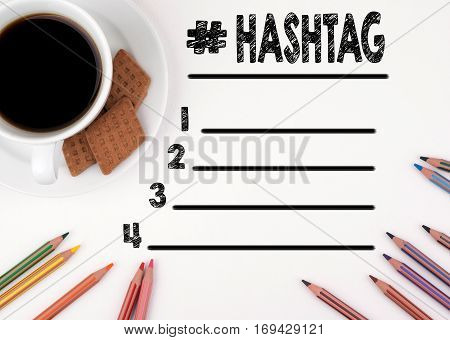 Hashtag blank list. White desk with a pencil and a cup of coffee.