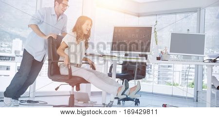 Designers having fun with a swivel chair in their office