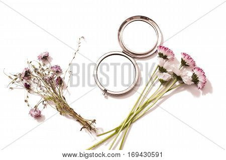 Bouquet of wild flowers and a mirror on a white background isolated .Gerbary. Flower composition . Copy space
