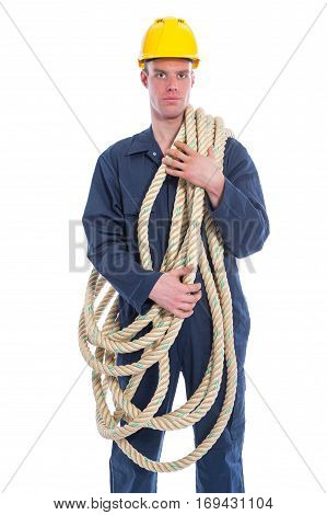 Worker in coverall and yellow helmet with large thick rope isolated on white background