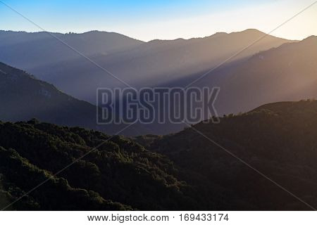 God rays stream through the mountains in the Los Padres National Forest.
