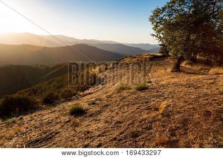God Rays stream through the mountains near Carmel Valley California.