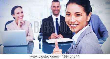 Young applicant in bright office giving thumb up after obtaining the job