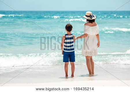 Back view of mother and son at Thai beach, Koh Phangan island, Thailand, Asia