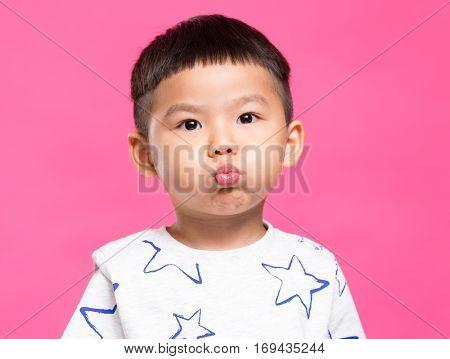 Asian little boy pout lip