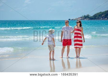 Young family of three having fun tropical beach, Koh Phangan island, Thailand, Asia
