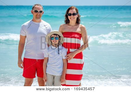 Happy beautiful family posing at beach during summer vacation, Koh Phangan island, Thailand, Asia