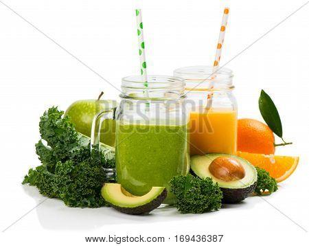 Orange and green smoothie with ingredients on white: avocado apple kale orange. Isolated on white background.