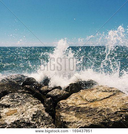 Action shot of ocean impacting the stubborn coastal rocks