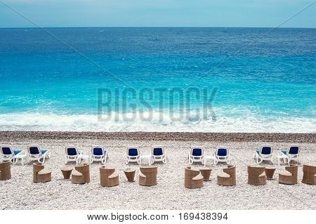 Chairs and tables on Nice beach along Promenade des Anglais to rent out by the day, or hourly to the public