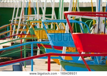 Empty Playground and swings in colorful park Russia.