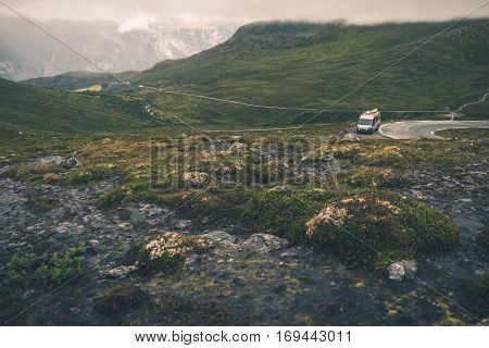 RV Trip in Scandinavia. Wild Norway Mountains Landscape and the Camper Van on the Road.