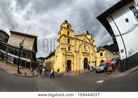 BOGOTA COLOMBIA - APRIL 23: Unidentified people walk past The Church of our Lady of Candelaria on April 23 2016 in Bogota Colombia.