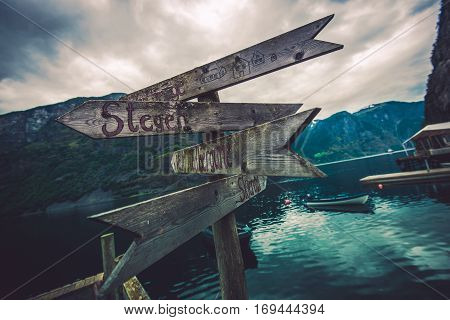 Wooden Direction Sign Somewhere in Norway. Traveling in Norway Photo Concept.