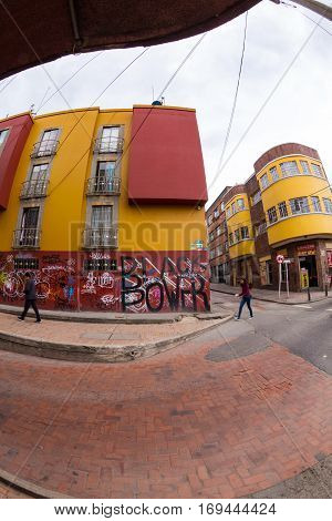 Bogota Colombia - April 21: Unidentified people walk past a black power mural in the Candelaria on April 21 2016 in Bogota Colombia.