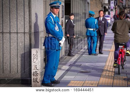 KYOTO, JAPAN - NOVEMBER 11, 2016: Police squad on duty on the street of Kyoto, Japan. Kyoto was formerly the Imperial capital of Japan for more than one thousand years.