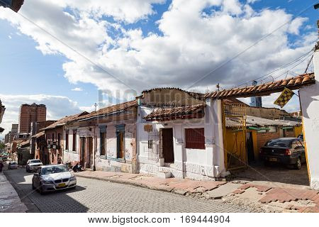 BOGOTA COLOMBIA - APRIL 21: Cars drive up the street the candelaria neighborhood on April 21 2016 in Bogota Colombia.
