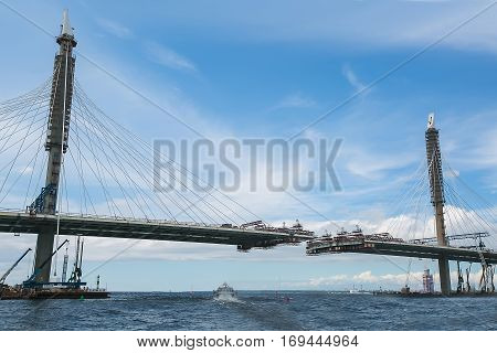 The construction of a bridge across the river. the view from the ship.