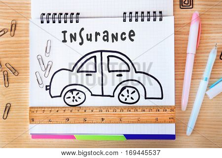 Car insurance concept. Car drawing in notebook
