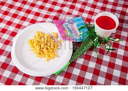 Birthday party with macaroni and cheese and drink.