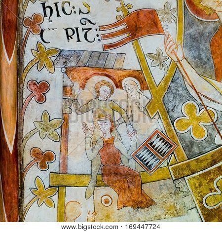 Playing medieval board game, Romanesque fresco in St. Bendt church Ringsted, Denmark - February 20, 2015