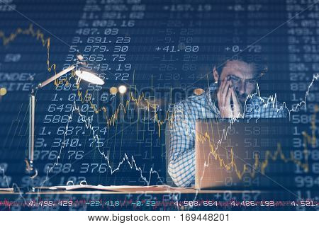 Stocks and shares against overworked businessman working at night
