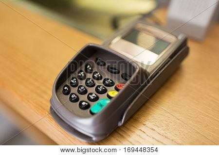 finance, money, technology, payment and people concept - close up of bank card reader or atm terminal