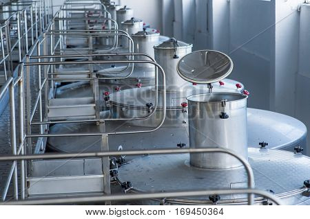 Contemporary large steel barrels in winery food industry