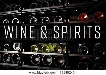 Shelving with different wine bottles in winery shop. Text WINE AND SPIRITS on background