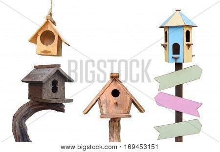 Different types of wooden bird houses isolated on white background