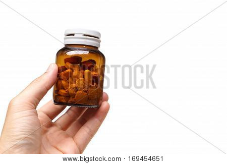 Hand holding a bottle of expired medicine