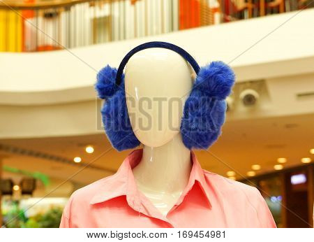 Ear muffs on model in department store
