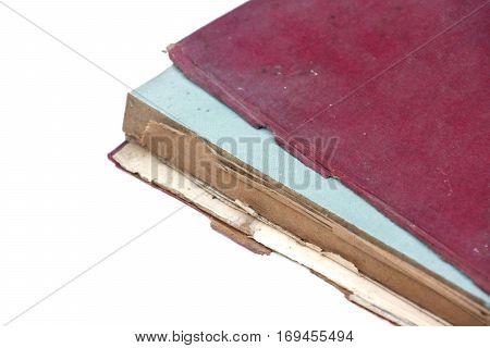 Old book with damaged cover isolated on white