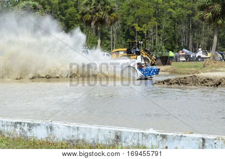 Naples Florida USA - March 3 2012: High-powered swamp creates big rooster tail