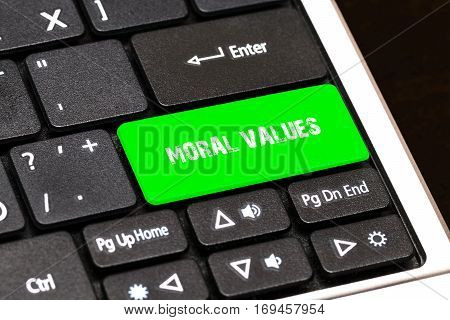 On The Laptop Keyboard The Green Button Written Moral Values