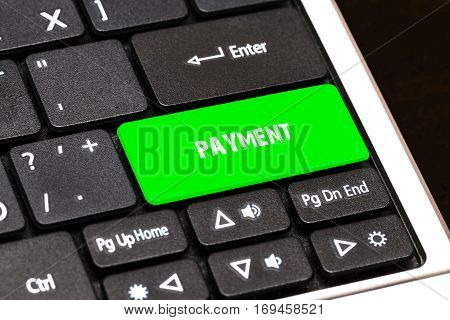 On The Laptop Keyboard The Green Button Written Payment