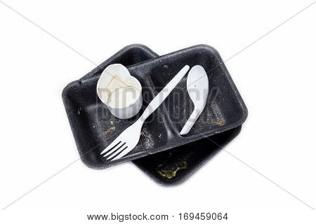 Garbage from take away food. Black foam food box and plastic spoon and fork