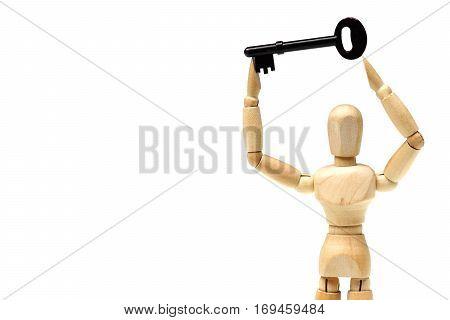 Wood Figure Mannequin carrying a key / Business success concept