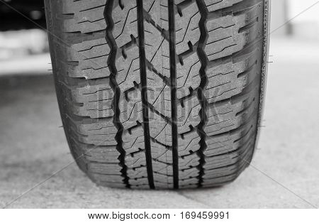 New tire full of tire tread / Checking tire tread depth for road safety