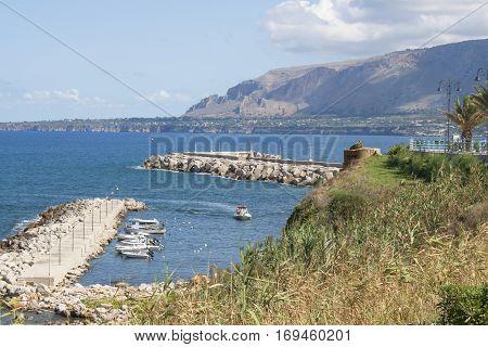Coastline view from Via Marina of a boat marina next to the beach