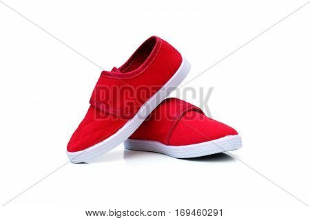 Red slip on shoes isolated on white background