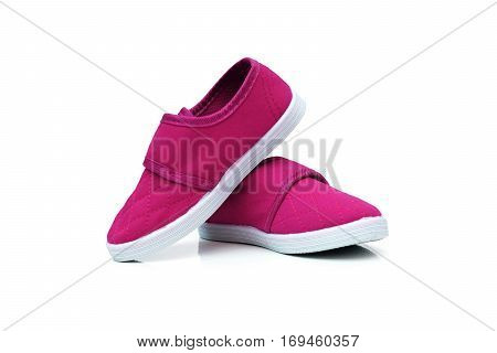 Magenta slip on shoes isolated on white