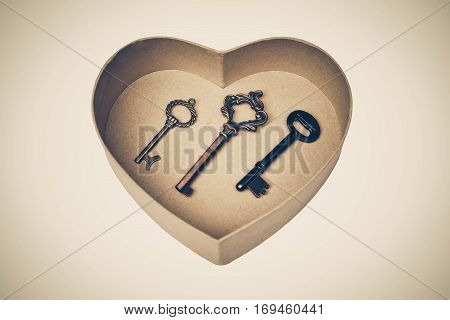 A heart shape box with three different keys in side / Key for love concept