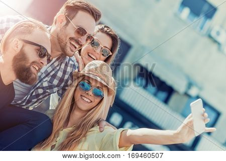 Best friends taking selfie outdoors.Happy young people having fun together.