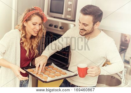 Happy couple making cookies at home.Family,food,happiness and people concept.