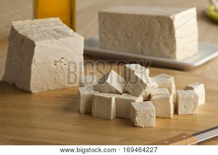 Fresh cut pieces of raw tofu
