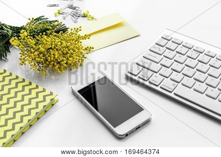 female desktop with smartphone and flowers mock up no one