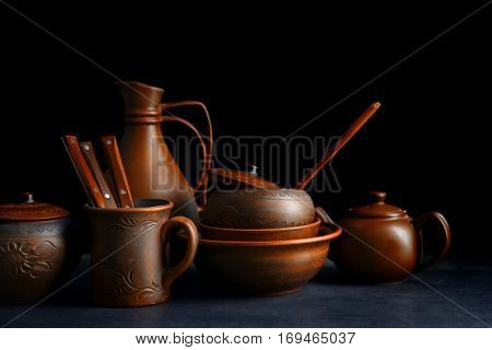 Brown dishware on table and black background